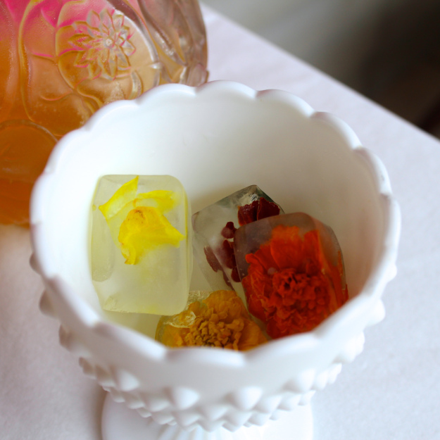 Edible flowers frozen into ice cubes