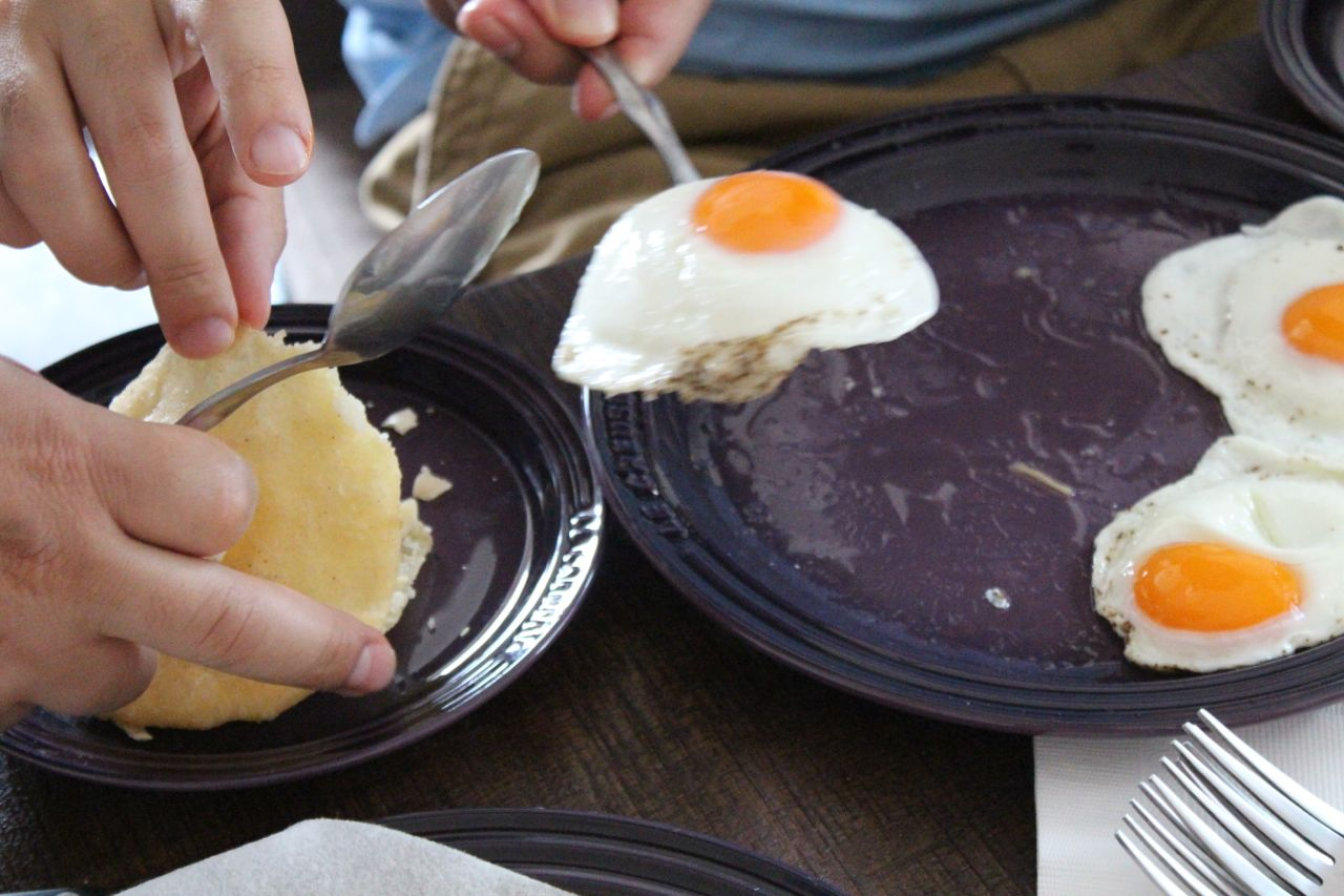 fried egg and arepas