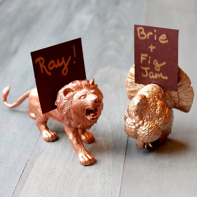 gilded animal place settings from www.alyssaandcarla.com
