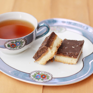 Dark Chocolate Salted Caramel Shortbread Squares from www.alyssaandcarla.com