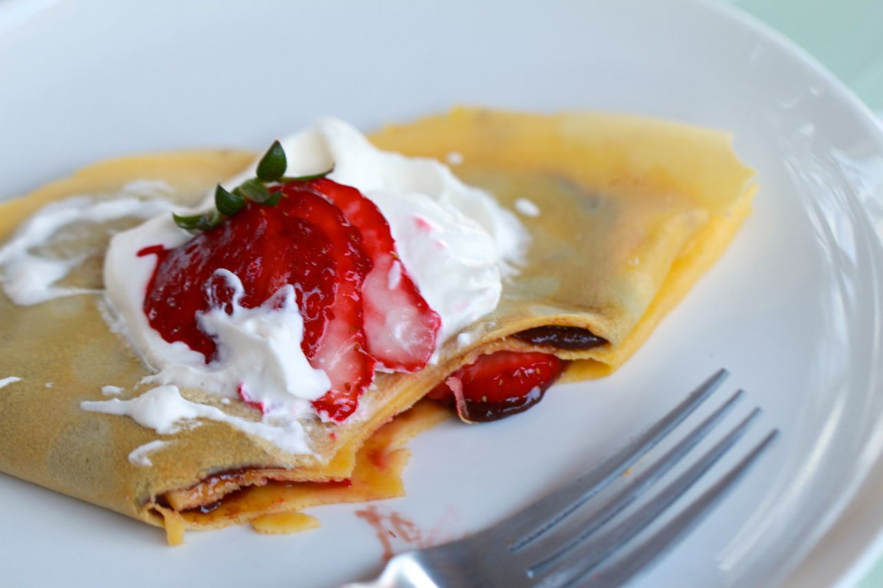 half eaten Nutella and strawberry crepes from www.alyssaandcarla.com