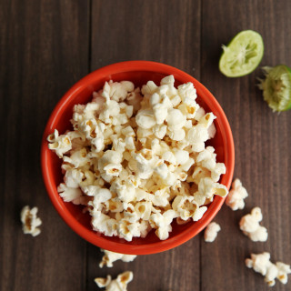 Popcorn with Garlic Lime Butter from alyssaandcarla.com
