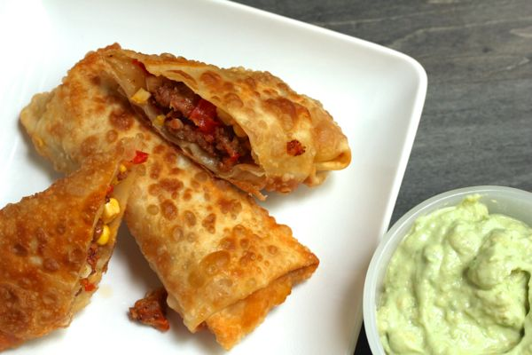 corn, bacon and chorizo egg rolls with avocado crema from www.alyssaandcarla.com