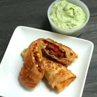egg rolls with corn, bacon and chorizo with avocado crema from www.alyssaandcarla.com