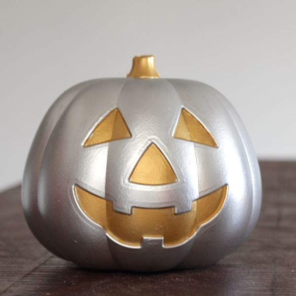 metallic jack-o-lantern from a dollar store pumpkin at wwwl.alyssaandcarla.com