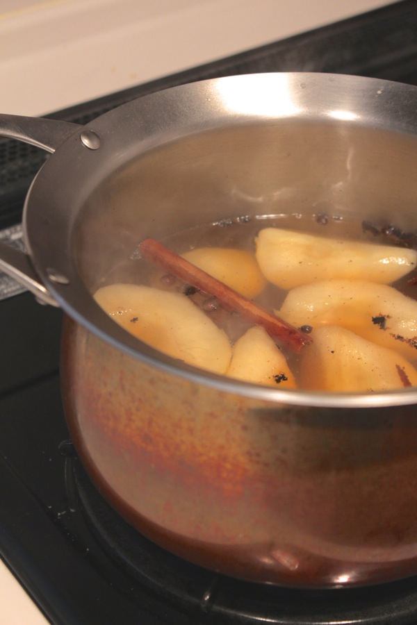 pears poaching on the stove from www.alyssaandcarla.com