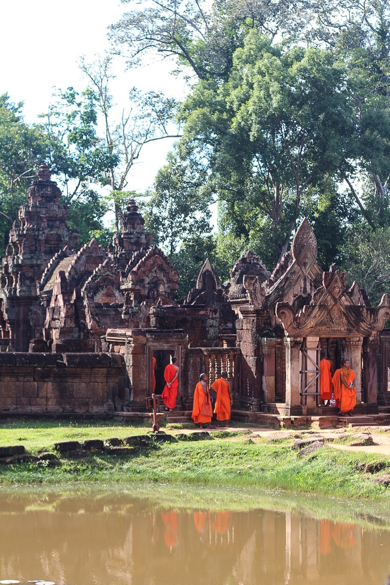 T10 (+3 bonus) tips to prepare for travel to Southeast Asia - Buddhist Monks at the Pink Limestone Temple in Siem Reap, Cambodia
